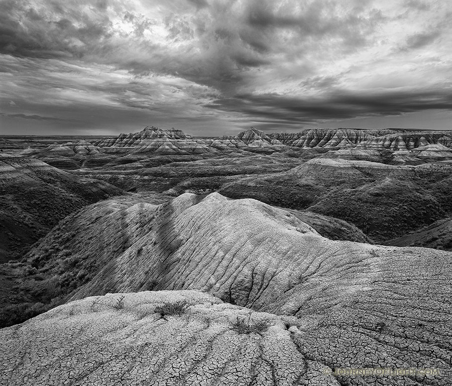 Rocks and formations under stormy skies in Badlands National Park, South Dakota. - South Dakota Photography