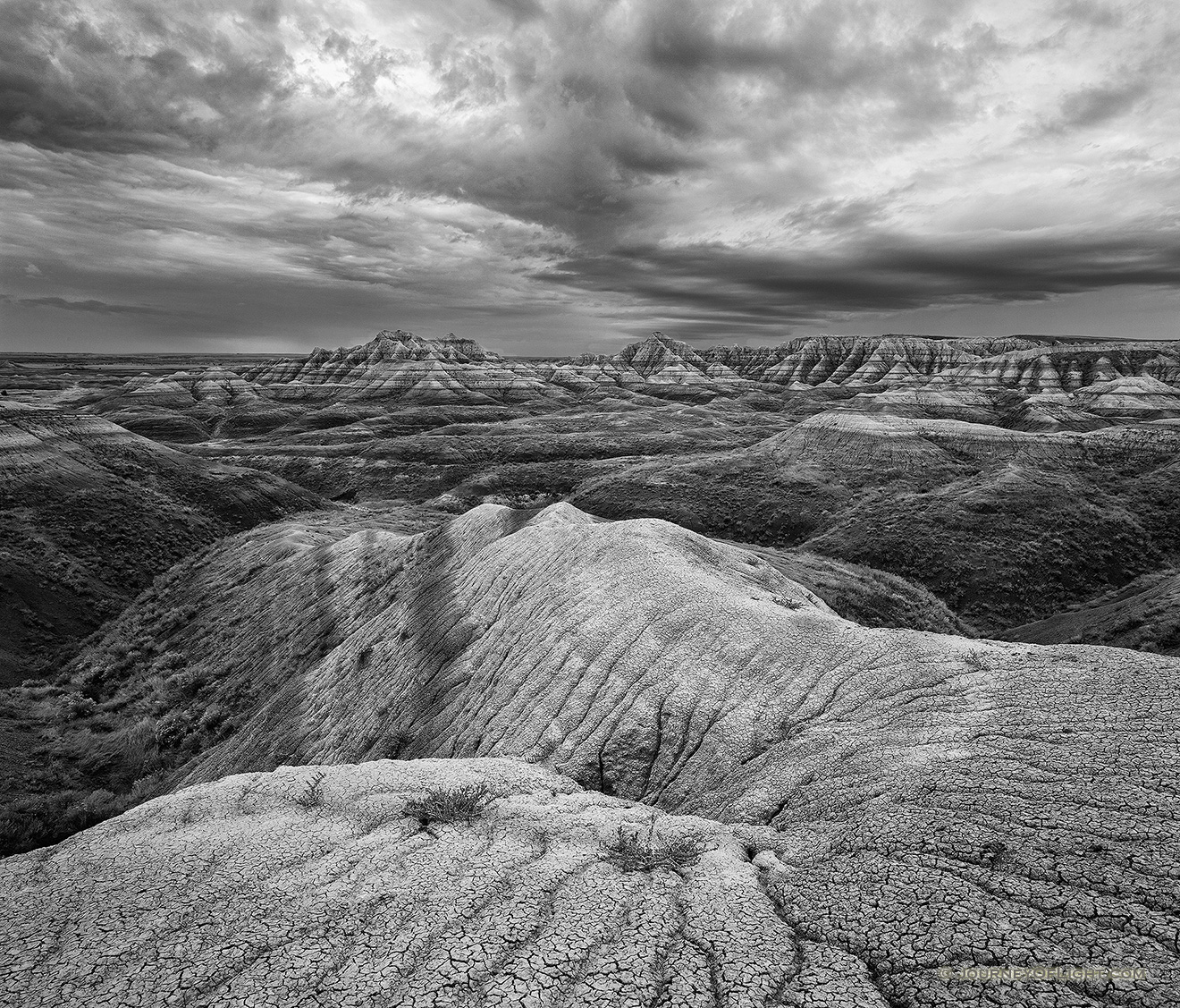 Rocks and formations under stormy skies in Badlands National Park, South Dakota. - South Dakota Picture