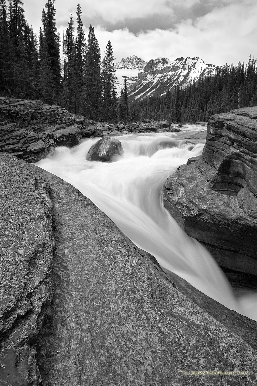 Water runs fast through Mistaya Canyon in the spring during the snow melt. - Canada Picture