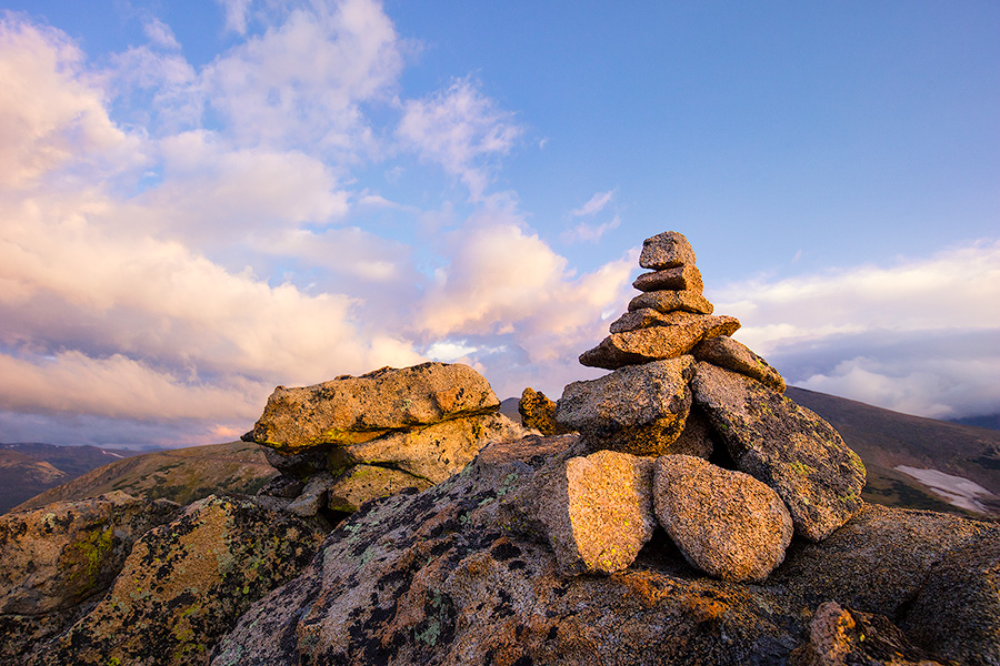 High up in Rocky Mountain National park a cairn stands witness to a beautiful morning across the tundra. - Colorado Photography