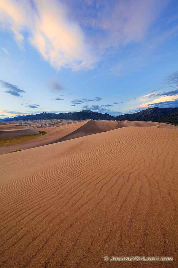 A rare combination of geologic forces combine to create these massive dunes, the largest in North America.  Rising in the distance is Mt. Herard, one of the tallest mountains of the San Juan range. - Great Sand Dunes NP Photography