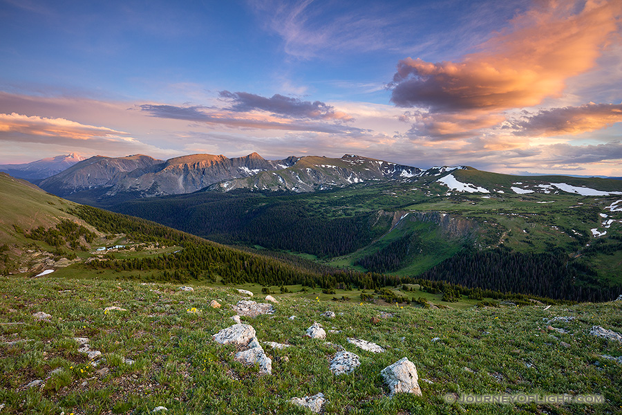 Clouds gather above the tops of the mountains in Rocky Mountain National Park as the last warm glow of sunset grazes the peaks. - Colorado Photography