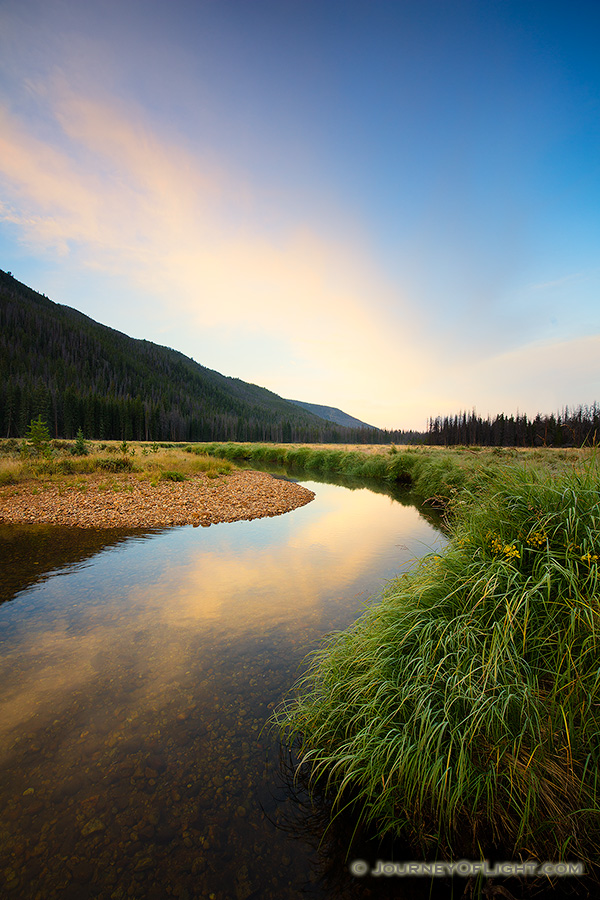 On the west side of Rocky Mountain National Park, the North Inlet stream snakes through a meadow and reflects a beautiful autumn sunrise. - Colorado Photography