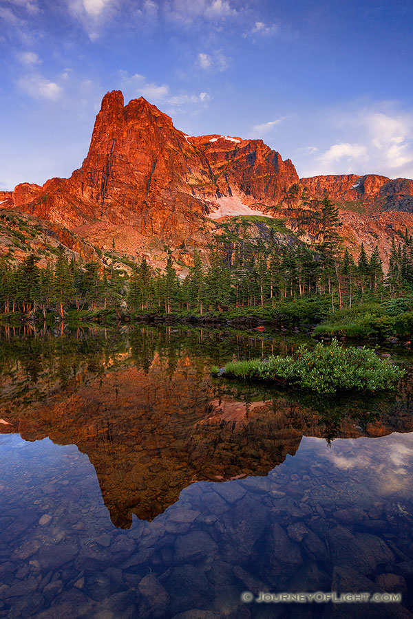 I had first hiked to Lake Helene about 5 years prior on a crisp fall day and on that visit became one of my favorite locations in Rocky Mountain National Park.  I took another opportunity to visit this scenic location, this time in the summer.  As the sun rose, Notchtop glowed with a brilliant warmth similar to what I had witnessed on the prior visit.  This year, however, the water was calm and reflected the beautiful scene that was before me. - Rocky Mountain NP Photography