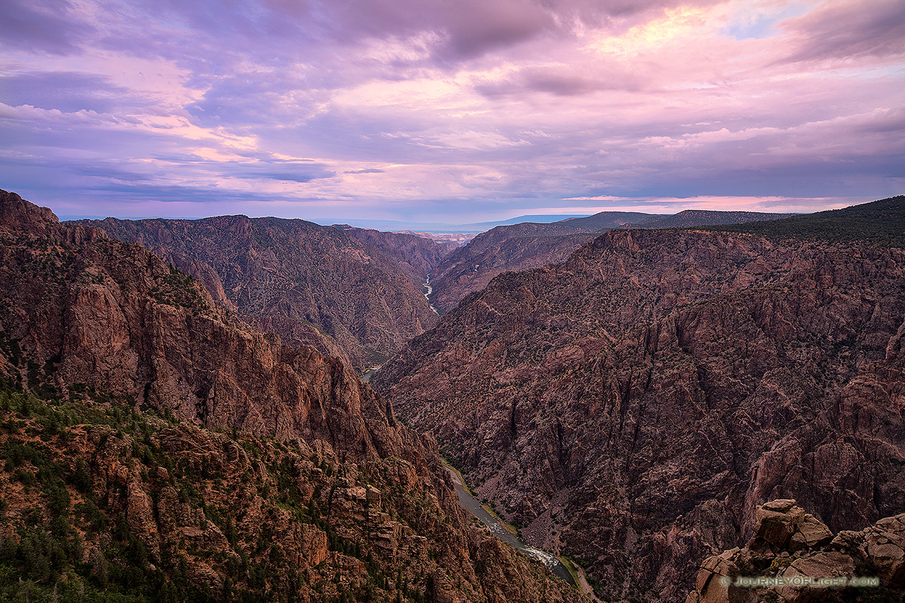 Pastel hues dominate the sky and are reflected throughout the canyon during a beautiful summer sunrise. - Colorado Picture