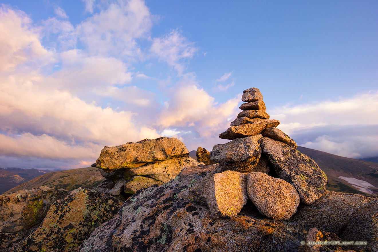 High up in Rocky Mountain National park a cairn stands witness to a beautiful morning across the tundra. - Colorado Picture