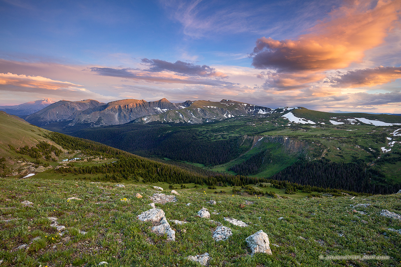 Clouds gather above the tops of the mountains in Rocky Mountain National Park as the last warm glow of sunset grazes the peaks. - Colorado Picture