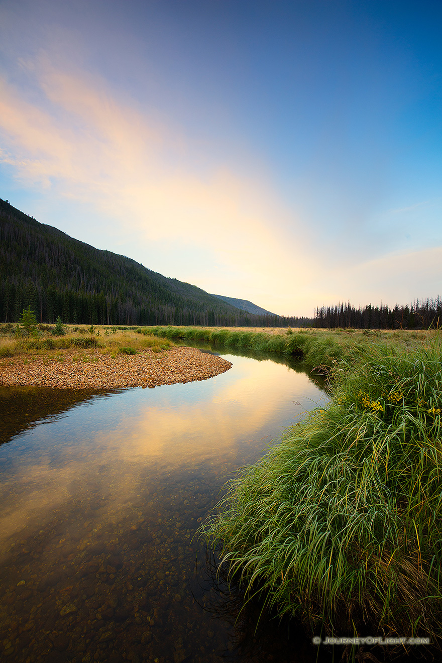 On the west side of Rocky Mountain National Park, the North Inlet stream snakes through a meadow and reflects a beautiful autumn sunrise. - Colorado Picture