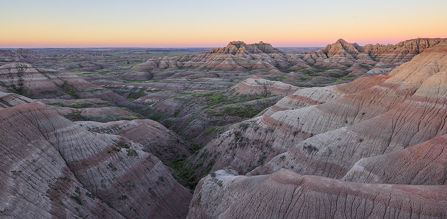 A panoramic scenic photograph of the sunrise over the Badlands National Park, South Dakota. - South Dakota Photography