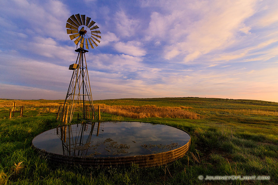 The previous night a storm had moved through Sandhills and Crescent Lake National Wildlife Refuge in western Nebraska.  As the morning sun rose in the east, the grasses and clouds glowed with vibrant pastel colors. - Nebraska Photography