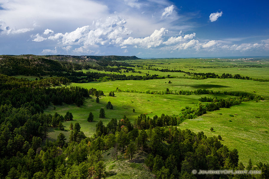 Gilbert-Baker WMA is part of the Pine Ridge escarpment in extreme western Nebraska.  It is so close to Wyoming, in fact, that the ridge that is furthest in the distance is the state border.  On this spring day I watched as storm clouds rolled through dropping rain and leaving everything a verdant green. - Nebraska Photography