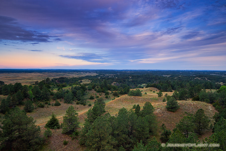 Clouds roll over Halsey National Forest in the central Nebraska.  From the Scott Tower lookout the largest handplanted forest in the United States extends into the distance. - Sandhills Photography