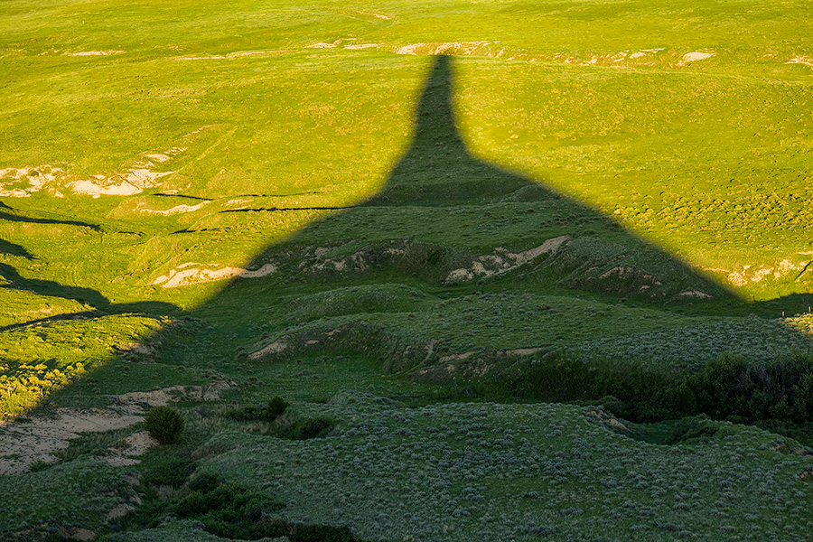Chimney Rock's shadows stretches out across the plains as the sun dips low in the western sky. - Nebraska Photography