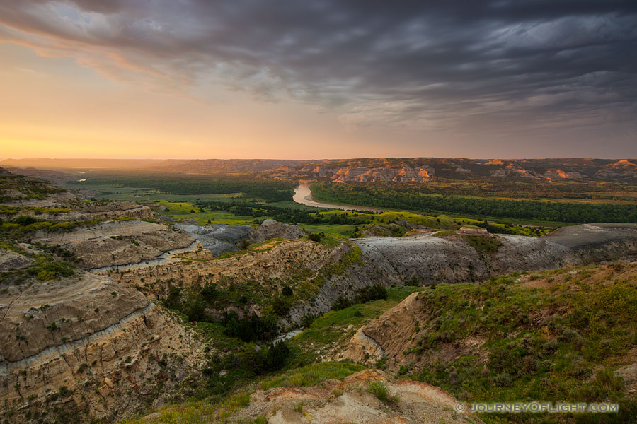 Sunlight streams across the Little Missouri valley in the North Unit of Theodore Roosevelt National Park, North Dakota. - North Dakota Photography