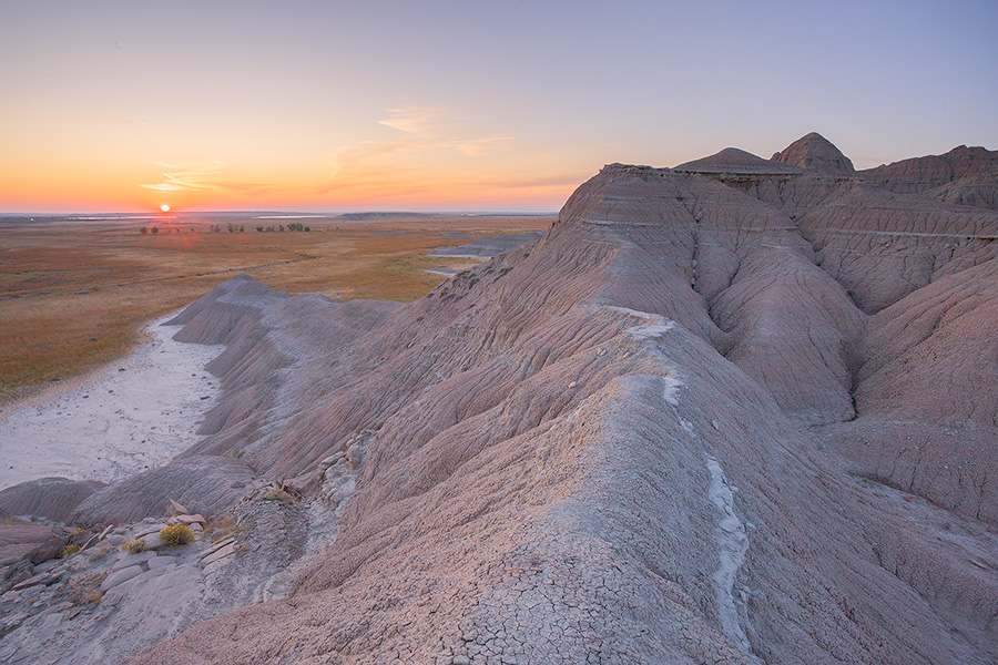 The sun rises over the western Nebraska plains from atop a ridge in Toadstool Geologic Park. - Toadstool Geologic Park Photography
