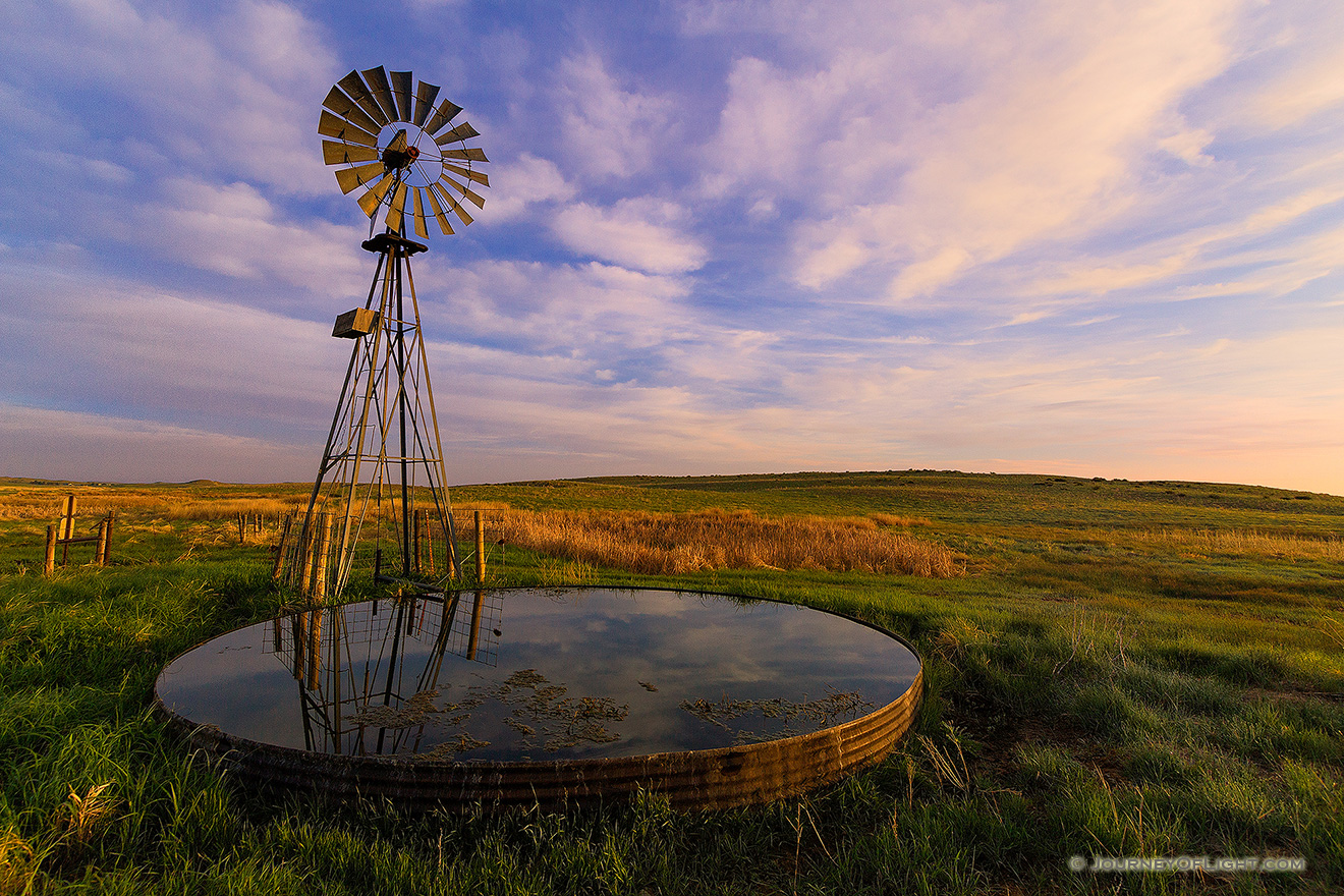 The previous night a storm had moved through Sandhills and Crescent Lake National Wildlife Refuge in western Nebraska.  As the morning sun rose in the east, the grasses and clouds glowed with vibrant pastel colors. - Nebraska Picture