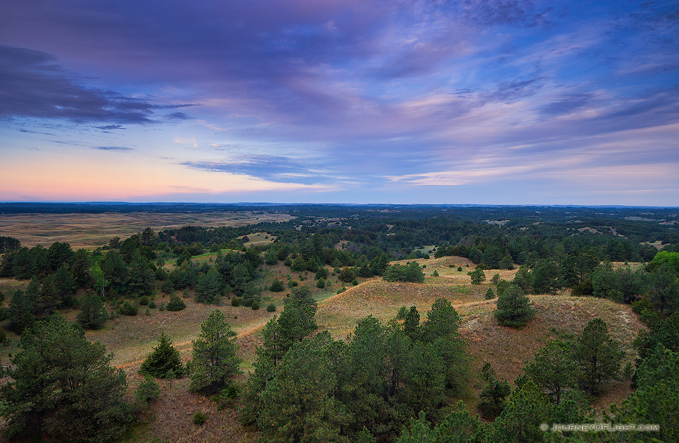 Clouds roll over Halsey National Forest in the central Nebraska.  From the Scott Tower lookout the largest handplanted forest in the United States extends into the distance. - Sandhills Picture