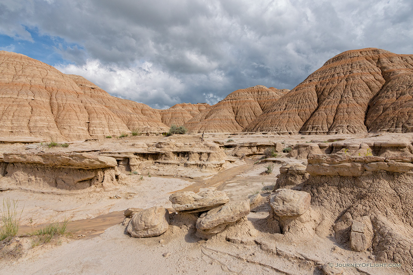 Afternoon clouds hover over the otherwordly landscape at Toadstool Geologic Park in Northwestern Nebraska. - Toadstool Geologic Park Picture