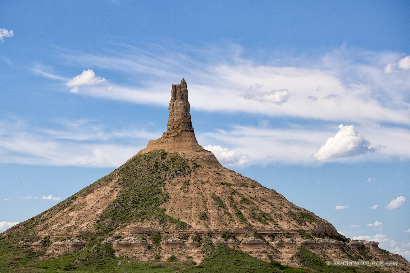 Clouds float above Chimney Rock, once a beacon to pioneers headed to the west for a better life. - Nebraska Picture