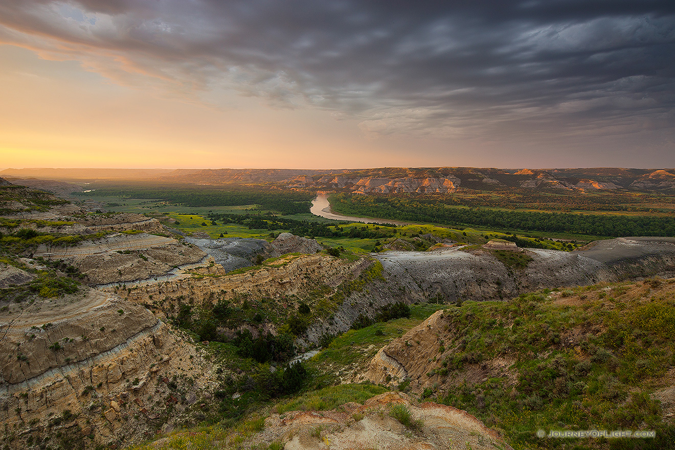 Sunlight streams across the Little Missouri valley in the North Unit of Theodore Roosevelt National Park, North Dakota. - North Dakota Picture