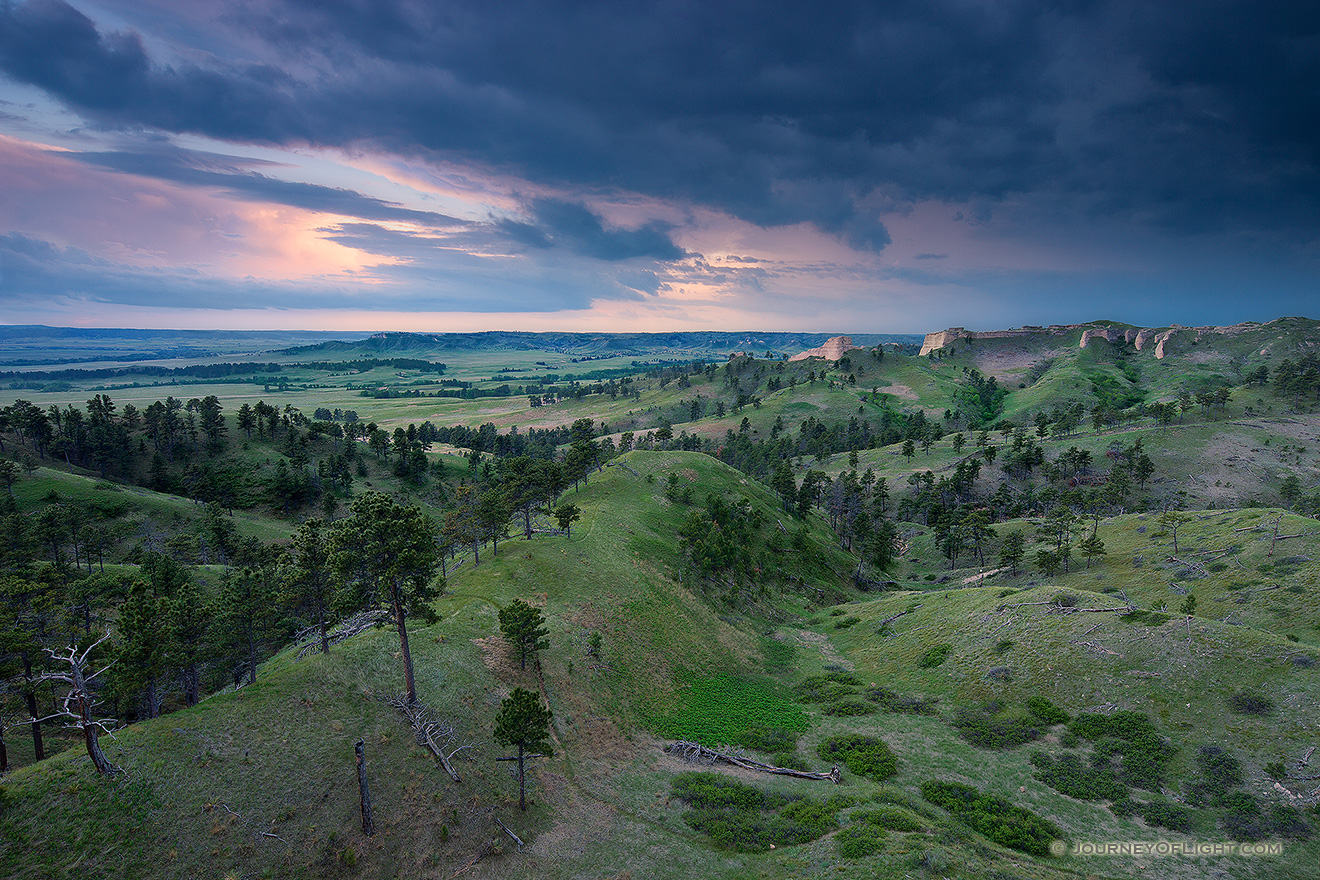 Clouds form in the evening over Ft. Robinson State Park in northwestern Nebraska.  Originally, a U.S. Army fort it has a checkered history in regards to the conflicts with Native Americans in the late 1800s. - Nebraska Picture