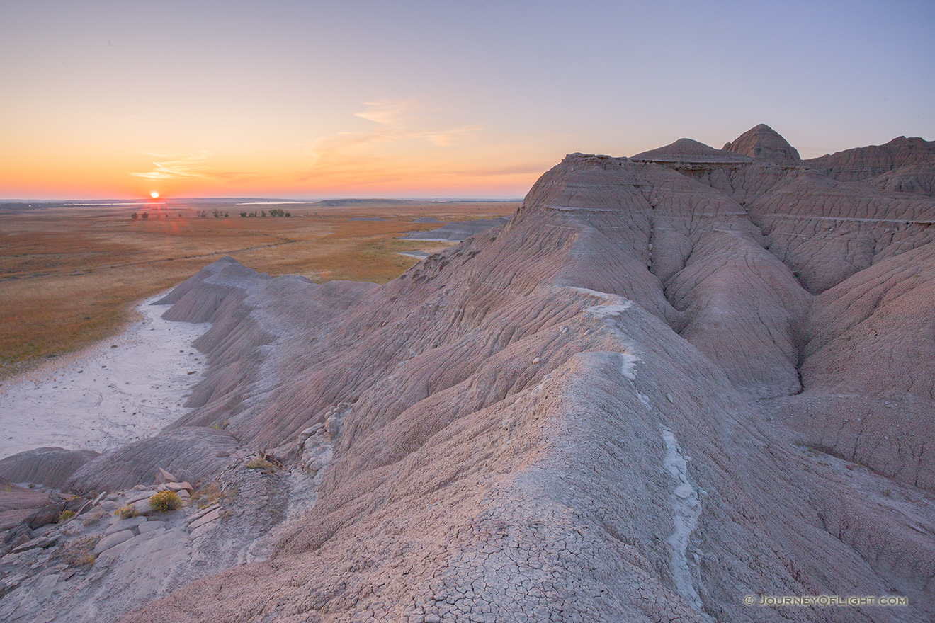 The sun rises over the western Nebraska plains from atop a ridge in Toadstool Geologic Park. - Toadstool Geologic Park Picture